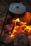 Preparing food on campfire. In wild camping, resting on the nature Royalty Free Stock Photos