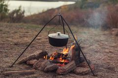 Preparing food on campfire. In wild camping, resting on the nature Royalty Free Stock Photography