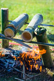 Preparing food on campfire. In wild camping Royalty Free Stock Photography