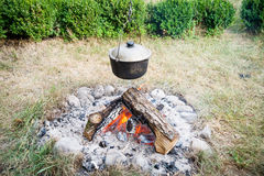 Preparing food on campfire. In wild camping Stock Photo