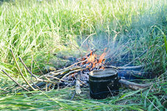 Preparing food on campfire. In wild camping Royalty Free Stock Image