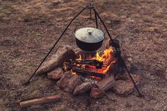 Preparing food on campfire. In wild camping, resting on the nature Stock Photo