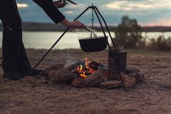 Preparing food on campfire. In wild camping, resting on the nature Stock Photos