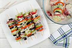 Preparing food for cooking barbecue on skewers Stock Images