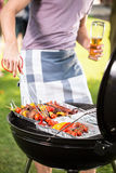 Preparing food on garden grill royalty free stock images