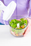 Preparing food with hand blender Stock Images