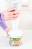 Preparing food with hand blender Stock Image