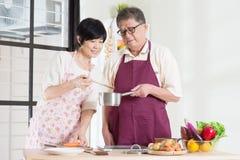 Preparing food at kitchen Stock Photos