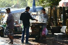 Preparing food in the street of Bangkok Royalty Free Stock Image