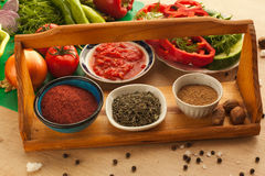 Preparing food for vegans, vegetables with spices. Healthy organic food for everyone in the kitchen. Vegetarian products Stock Photo