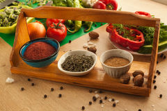 Preparing food for vegans, vegetables with spices. Healthy organic food for everyone in the kitchen. Vegetarian products Stock Image