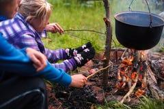 Preparing food in wilderness Stock Images