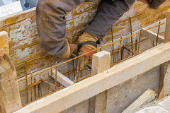 Preparing form for concrete with reinforcing rods 3 Stock Photography