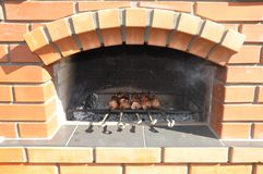 Preparing fresh beef steak on grill Stock Photo