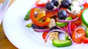 Preparing fresh ceasar salad stock video
