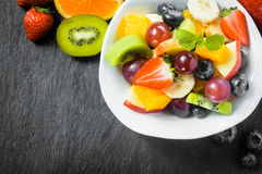Preparing fresh fruit salad for breakfast Stock Image