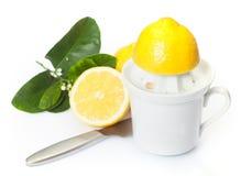 Preparing fresh lemon juice stock image