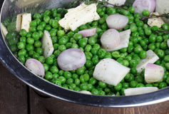 Preparing fresh Peas Stock Photo