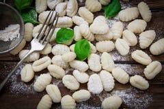 Italian fresh pasta. Preparing fresh potato gnocchi on wood board Stock Images