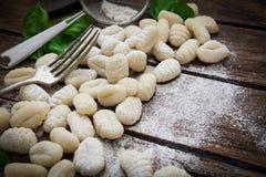 Italian fresh pasta. Preparing fresh potato gnocchi on wood board Stock Photography