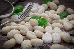 Italian fresh pasta. Preparing fresh potato gnocchi on wood board Royalty Free Stock Image