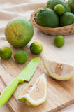Preparing fresh sour orange and limes. Royalty Free Stock Photo