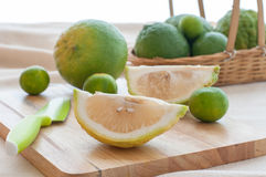 Preparing fresh sour orange and limes. Royalty Free Stock Photography