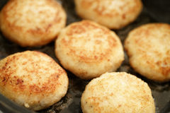 Preparing fried fish cakes on pan. Shallow focus Royalty Free Stock Image