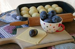 Preparing of fruit dumplings stuffed with plums Royalty Free Stock Photo