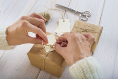 Preparing gifts for Christmas Stock Images