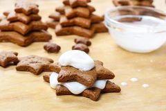 Preparing gingerbread christmas tree. Steps of making delicious and decorative xmas dessert Stock Photos