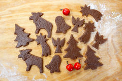 Preparing gingerbread cookies for christmas Stock Photos