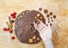 Preparing gingerbread cookies for christmas Royalty Free Stock Images