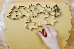Preparing gingerbread cookies for christmas Royalty Free Stock Image