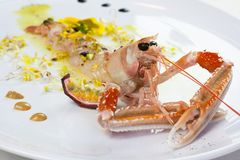 Crustacean cooked and presented in an elegant gourmet composition. Preparing a gourmet plate in a restaurant Stock Image