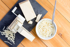 Preparing grated gruyere cheese for cooking Stock Photos