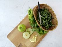 Preparing for green smootie or apple salad