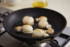Preparing grilled cuttlefish in a pan Stock Images