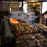 Preparing grilled skewed meat on bbq in restaurant.  Stock Photography