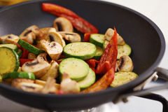 Preparing grilled vegetables in a pan Stock Photos