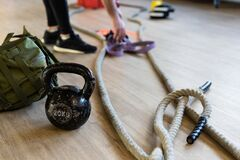 Free Preparing Gym Equipment For Boot Camp And Work Out. Kettle Bell, Rope, Sandbag In Gym Hall Stock Photo - 185925300