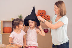 Preparing for Halloween party. Mother and daughters preparing for Halloween party Stock Photography