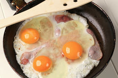 Preparing ham and eggs Stock Photo