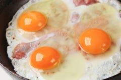 Preparing ham and eggs Stock Photography