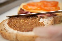 Preparing ham sandwich in a cafeteria Royalty Free Stock Photography