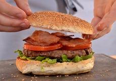 Preparing hamburger. Royalty Free Stock Images