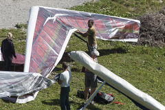 Preparing the Hand glider for take-off Stock Photos