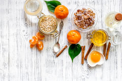 Preparing healthy breakfast. Cereals with oranges, honey, cinnamon on wooden table background top view copyspace. Preparing healthy breakfast with oranges on royalty free stock photos