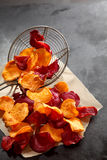 Preparing healthy crispy beetroot chips Royalty Free Stock Photography