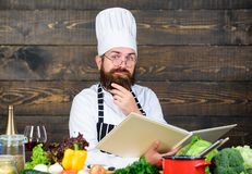 Preparing healthy food. Dieting with organic food. Fresh vegetables. Professional chef in cook uniform. Vitamin. man use. Kitchenware. concentrated man cooking royalty free stock photos